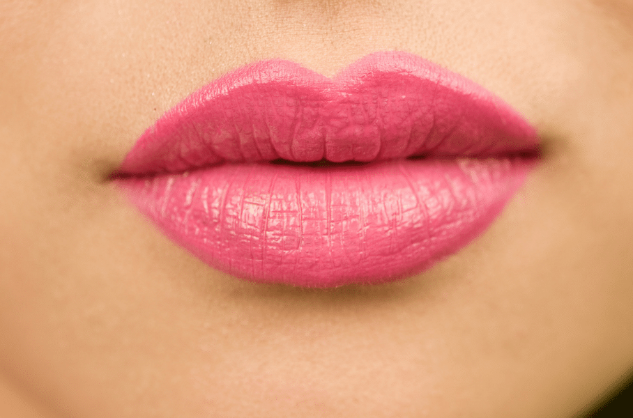 woman's voluptuous lips with pink lipstick